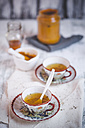 Cup of turmeric tea spiced with pepper - SBDF000751