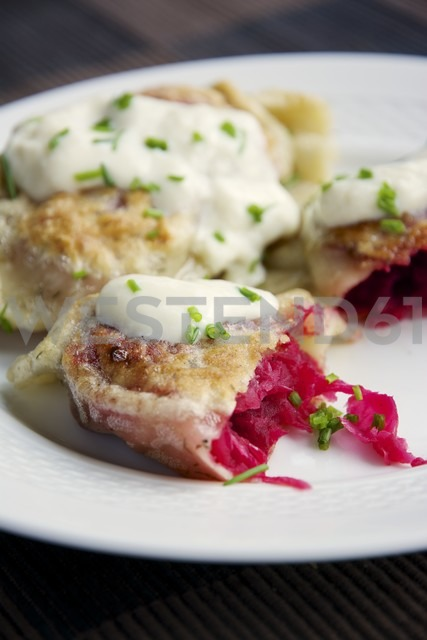 Fried herbed pierogi with a beet, sauerkraut and potato filling, served with soy yogurt and chives - HAWF000069