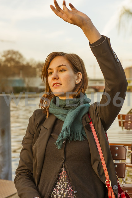 Germany, Berlin, female tourist sitting at cafe near Spree River - FBF000313