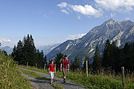 Germany, Bavaria, Berchtesgadener Land, Father and son hiking at Hoher Goell - LB000656
