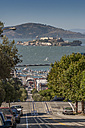 USA, California, San Francisco, street, pier and Alcatraz in the background - NKF000085