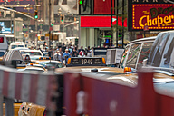 USA, New York State, New York City, A cab stuck in traffic at Times Square - NK000088