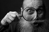 Portrait of an old man looking through magnifying glass - CvKF000035