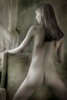 Female nude kneeling on armchair - CvK000044