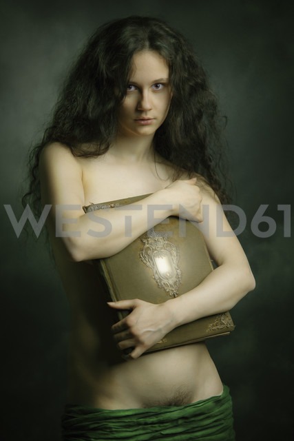 Barechested young woman holding book - CvK000051