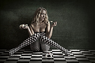 Blond young woman wearing checkered tights - CvK000080