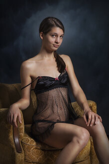 Woman in black negligee in armchair - CvK000115