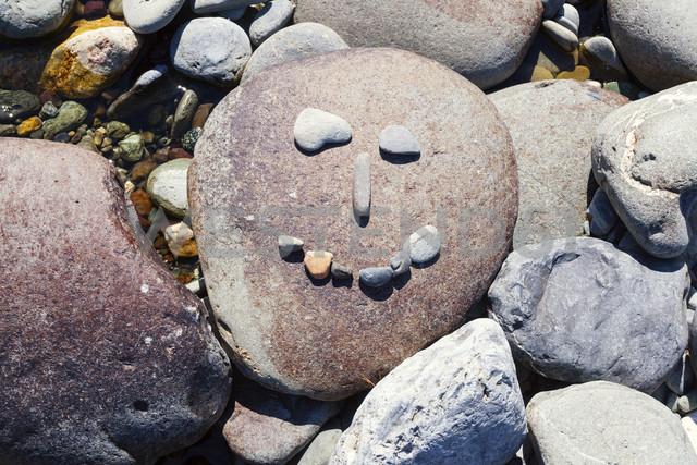 New Zealand, Marlborough Sounds, Pelorus river, smiley made of stones - WV000623