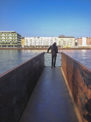 Germany, Berlin, Treptow, young man on pier - FBF000338