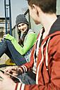 Teenager and teenage girl waiting on platform - UUF000198