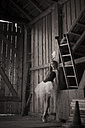 Young woman with tutu standing in barn - FCF000014