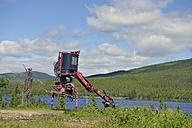 Sweden, Gaeddede, Lumbering machine at Vildmarksvaegen - BR000437