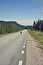 Sweden, Arvidjaur, Reindeer walking on street - BR000422