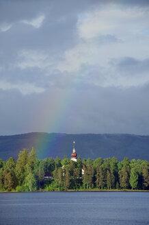 Sweden, Leksand, Rainbow above Lake Siljan with church - BR000330