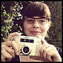 young woman with old camera, Germany, North Rhine-Westphalia, Minden - HOHF000688
