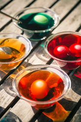 Germany, Bavaria, Colorful Easter eggs in dye - SARF000444