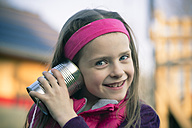 Portait of little girl with tin can phone - SARF000471