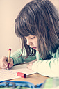 Portrait of little girl doing homework - LVF001040