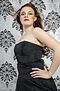 Portrait of young woman wearing little black dress - ECF000519