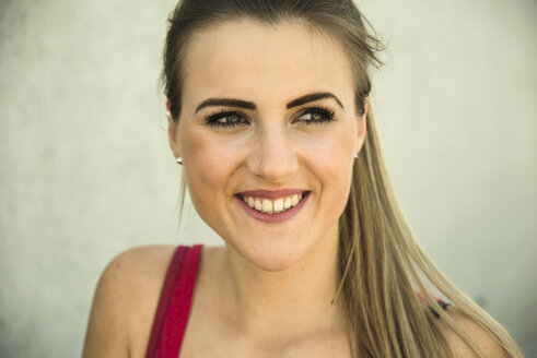Smiling blond young woman - UUF000236