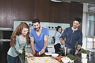 Portrait of four friends cooking together - RBF001676