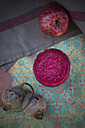 Glass of apple beetroot smoothie, apple and two beetroots on table, elevated view - LVF001047