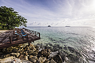 Thailand, Koh Phi Phi Don, Terrace with beach chairs at beach - THA000256