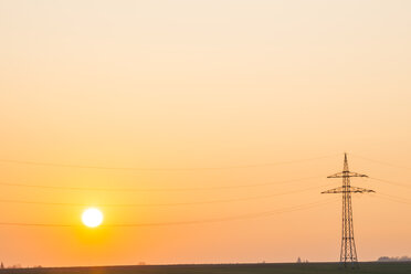 Germany, Baden-Wuerttemberg, Power pylon at sunset - WGF000272