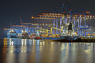 Germany, Hamburg, Port of Hamburg, Container Terminal Burchardkai at night - RJ000092