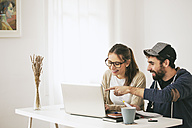 Young couple working at modern home office - EBSF000179