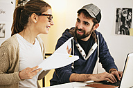 Young couple working together at modern home office - EBSF000158