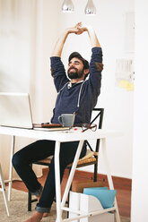 Man stretching at modern home office - EBSF000172