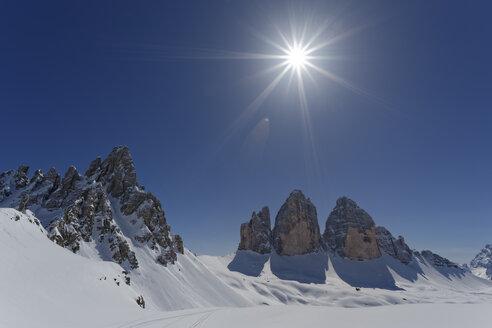 Italy, Alto Adige, Sexten Dolomites, Hochpuster Valley, Tre Cime di Lavaredo against the sun - GFF000434