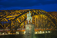 Germnay, North Rhine-Westphalia, Cologne, equestrian statue of emperor Wilhelm II in front of lighted Hohenzollern Bridge by night - WGF000274