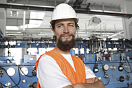 Worker with hard hat in a factory hall - SGF000572