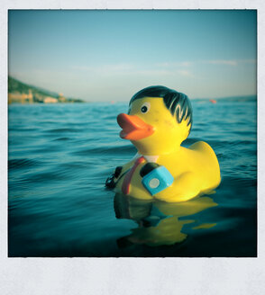 Bath Duck with camera swims in the sea, Croatia - ED000076
