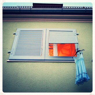 Dress hanging on window shutter, Munich, Bavaria, Germany - EDF000061
