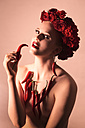 Portrait of pin-up girl wearing red flowers and decorated with red peppers - FCF000030