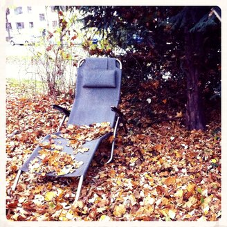 Deck chair in autumn foliage, Munich, Bavaria, Germany - EDF000054