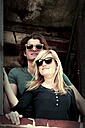 Portrait of young couple wearing sunglasses - HOHF000719