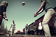 Group of five friends playing volley ball - HOHF000722