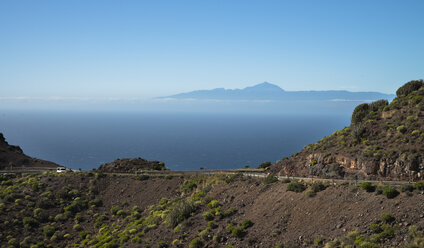 Spain, Canary Islands, Gran Canaria, Coastal road, Teneriffe in background - STCF000043