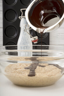 Pouring melted chocolate to Whoopie pie dough - CSTF000266