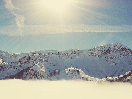Germany, Bavaria, Sudelfeld, Sunshine above clouds at ski resort - BRF000238