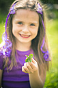 Little girl showing four leaved clover - SARF000495