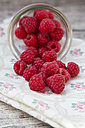 Glass of raspberries on cloth - LVF001072