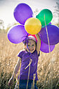 Laughing little girl with balloons - SARF000488