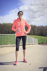 Portrait of female jogger having a break - VTF000210