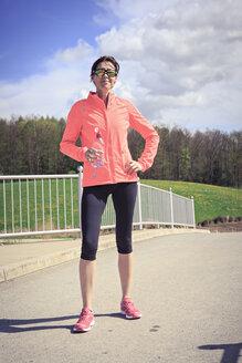 Portrait of female jogger having a break - VTF000210