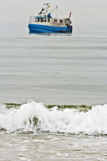 Germany, Baltic Sea, Fishing boat and wave - MELF000001